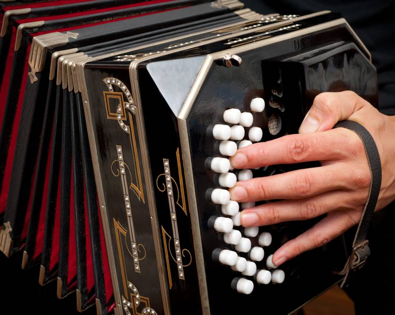 Playing the bandoneon, traditional tango instrument, Argentina
