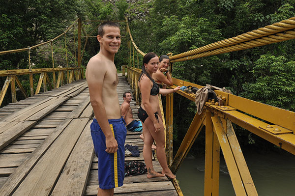 Jumping off the bridge near the Semuc Champey caves in Guatemala