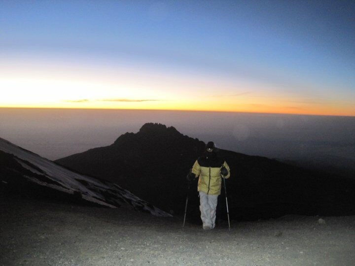 Sun rising as reaching Stella point on Kilimanjaro summit
